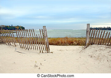 Lake Michigan Beach with Fence - Fence on a beach in Door...