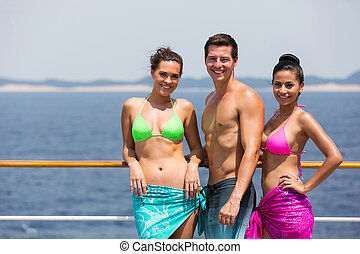 three friends on cruise - portrait of happy friends on a...