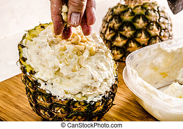 Fresh Pineapple and Toasted Coconut Dip - Female hands...