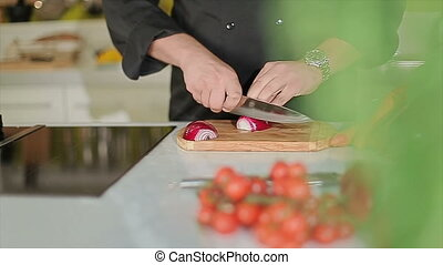 Cutting onion in the kitchen - Cook cutting onions with...