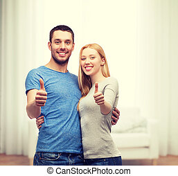 smiling couple showing thumbs up - couple, gesture and...