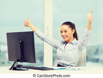 woman with computer, papers showing thumbs up - business,...