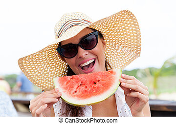 young woman having a slice of watermelon - happy young woman...