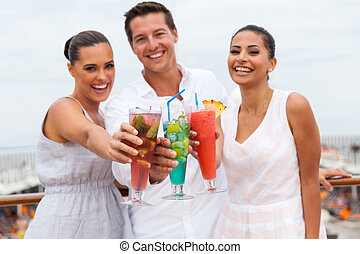 young people toasting with cocktail drinks - portrait of...