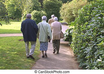 senior couples going out - people walking on a path