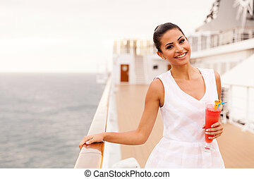 elegant young woman on a cruise vacation - portrait of...