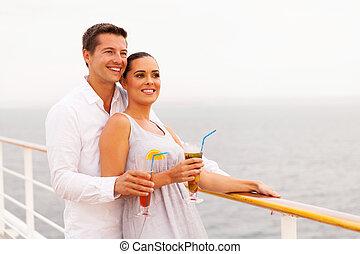 couple enjoying cruise vacation - beautiful couple enjoying...