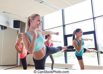 group of women working out in gym - fitness, sport, people,...