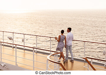 couple walking on cruise ship deck - cute couple walking on...