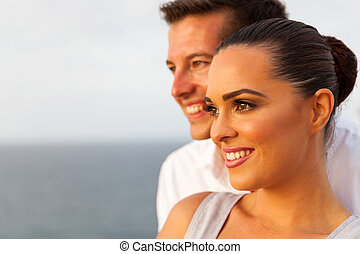 young woman with boyfriend looking away on cruise ship