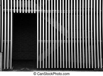Door and grill wall - Open door and grill wall in monochrome
