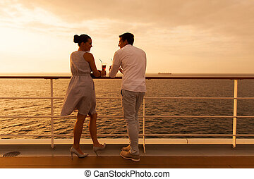 young couple on a cruise holiday - young couple enjoying a...