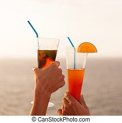 couple toasting with cocktail