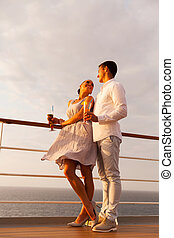 couple flirting during cruise trip - romantic young couple...