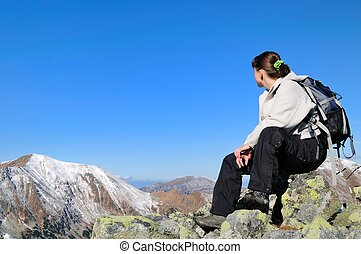 Relax on hiking - view on mountains - Hiker relaxing on...