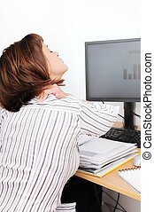 Business person working and holding her neck with pain -...