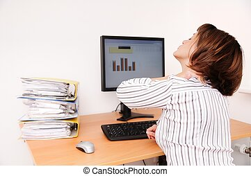 Business woman with neck pain sits on workplace with...