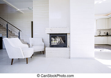 Fireplace in modern, new house - View of fireplace in...