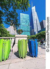 Skyscrapers and nature in Bryant Park, Manhattan, New York.