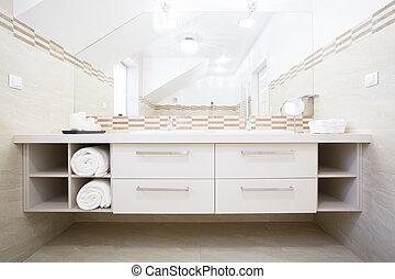White furniture in bright bathroom