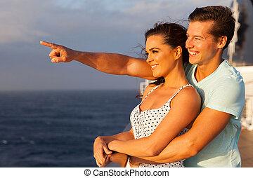 loving couple enjoying cruise - loving couple enjoying a...