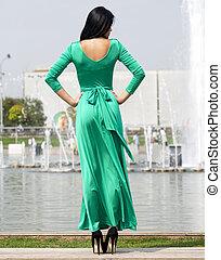 Beautiful young woman in green long dress - Young beautiful...