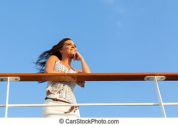 woman on cruise daydreaming - attractive woman on cruise...