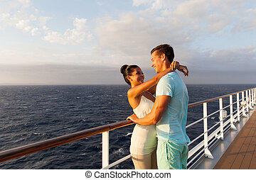young couple hugging each other on cruise - happy young...