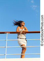 young woman enjoying sunset on cruise - relaxed young woman...