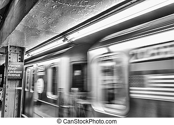 American flag on a fast moving subway train.
