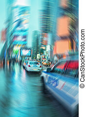 Blurred picture of New York police car in Times Square at...
