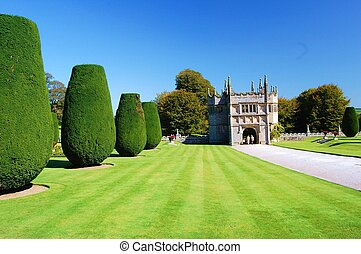 Yew Trees - Yew trees in beautiful garden with gate house.