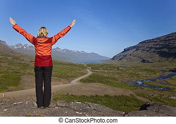 Woman Hiker Looking Down The Berufjordur Valley Iceland