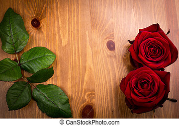 Two Valentine Roses With Leaf On Wood - Two valentine red...