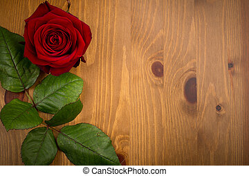 Rose And Leaf On Wood Backgound - A single red love rose...