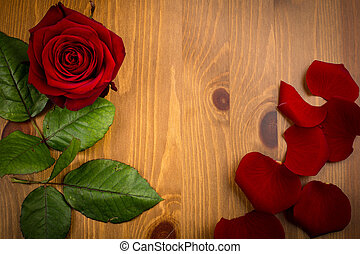 Single Rose And Pettles With Leaf On Wood - A single red...