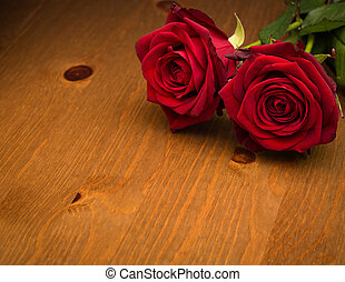 Two Red Roses On Brown Wood - Two red valentine love roses...