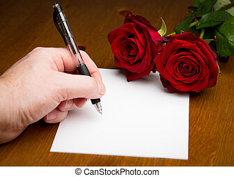 Hand Writing A Love Valentine Letter With Roses - Left hand...