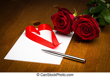 Ribbon Love Heart On Paper With Pen And Roses - A love heart...