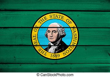 Washington State Flag on wood background