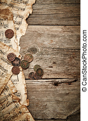 Vintage still life with old coins and music sheets on wooden...