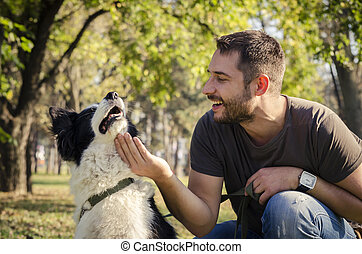 Man with his dog playing in the park