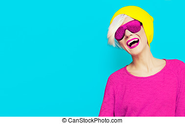 blond happy girl with a stylish cap and sunglasses on bright...