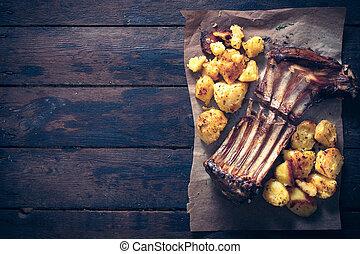 Lamb ribs and potatoes - Lamb ribs with baked potatoes from...