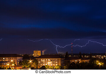 Storm with lightning in night over city in Czech republic