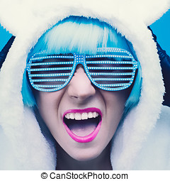 Screaming crazy girl in hoodie Teddy Bear on a blue...