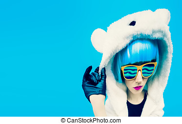Crazy party girl in hoodie bear on a blue background....
