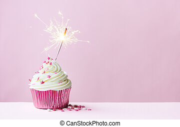 Celebration cupcake with sparkler - Pink cupcake decorated...