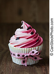 Pink cupcake with chocolate stars