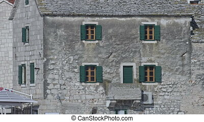 Primosten old house - Old stone house with green windows in...